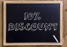10% discount. New chalkboard with 3D outlined text - on wood Stock Photo