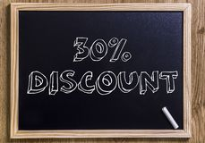 30% discount. 30%  discount - New chalkboard with 3D outlined text - on wood Royalty Free Stock Photos