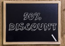 50%  discount. 50% discount - New chalkboard with 3D outlined text - on wood Royalty Free Stock Photography