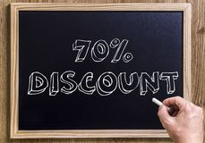 70% discount. New chalkboard with 3D outlined text - on wood - with hand Stock Photos