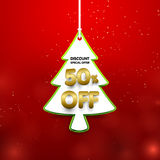 Discount 50 percent off. Christmas tree shape in price tag banner. Discount 50 percent off. Christmas tree shape in price tag Royalty Free Stock Images