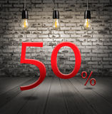 Discount 50 percent off with text special offer your discount in. Interior with white brick wall and wooden floor and classic Edison light bulb Stock Images