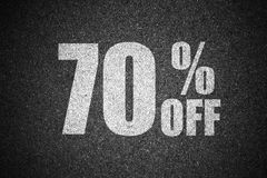 Discount percent sign on asphalt.  Royalty Free Stock Photo