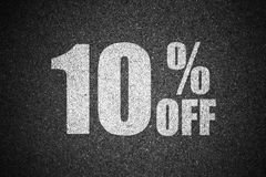 Discount percent sign on asphalt.  Royalty Free Stock Photography