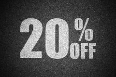 Discount percent sign on asphalt Royalty Free Stock Images