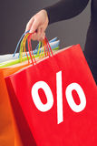 Discount Percentage Symbol on Red Shopping Bag Stock Photos