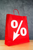 Discount Percentage Symbol on Red Shopping Bag Stock Photo