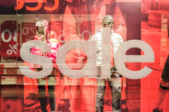 Discount Sales At Adidas Store. BUCHAREST, ROMANIA - JANUARY 28, 2015: Discount Sales At Adidas Store. Adidas is a German multinational corporation that designs Royalty Free Stock Photos