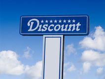 Discount Sign. A close up on a sign with the word Discount with a bright blue sky and clouds in the background Royalty Free Stock Photo