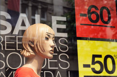 Discount signs in a shop window. Royalty Free Stock Photo