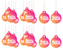 Discount Tags. Hanging colorful discount tags of 10, 20, 25 and 50%, isolated on white background Stock Images