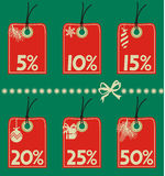 Discount tags. Hang tags with various discount amounts and holiday icons Royalty Free Stock Photo