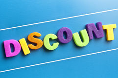 Discount word on blue board.  Stock Photo