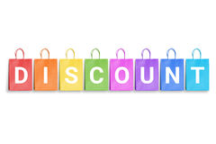 Discount word written on colorful shopping bags. Free space for text Royalty Free Stock Images