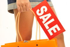 Woman holding orange bag, sale sign Royalty Free Stock Photos