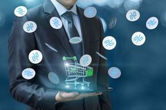 Discounts in the online store. Businessman with shopping cart and percentages fly Stock Photography