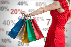 Discounts and shopping concept. Young woman holds many colorful shopping bags in hands Royalty Free Stock Image