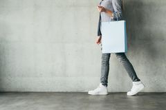 Discounts shopping spending woman holding bag. Discounts shopping and money spending concept. woman holding paper bag royalty free stock photos