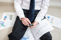 Discouraged businessman sitting on the floor Stock Image