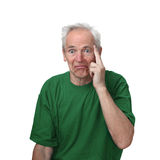 Discouraged man. Senior man with discouraged face put fingers to his temple isolated on white background Stock Photos