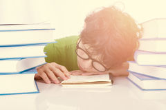 Discouraged student sleep at table in front of his homework. Discouraged student sleep on table in front of his homework Stock Photo
