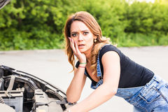 Discouraged woman having problems with her car Royalty Free Stock Images