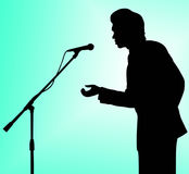 discours de silhouette de microphone d'homme à Photos stock