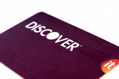 Discover credit card close up on white background. Selective focus with shallow depth of field Stock Photography