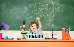 Discover liquids. Study grants and scholarship. Boy performing chemistry test. Wunderkind and early development. Small. Pupil learn chemistry school. Chemistry royalty free stock photography