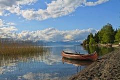 Discover Ohrid Lake by Kanu. Ohrid Lake with a nice Kanu, beautiful reflection and nice colors, Lagadin Ohrid Macedonia Royalty Free Stock Photos