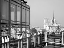 Original view on the Notre-Dame-de-Paris cathedral, black & white. Walking in the street of Paris - View from l`Institut du monde arabe Royalty Free Stock Image