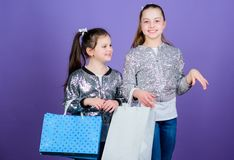 Discover something new. Girls sisters friends with shopping bags violet background. Shopping and purchase. Black friday stock photos