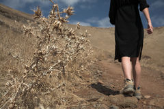 Discover unknown places. Hiking at dry mountain roads Stock Photography