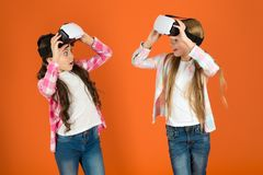 Discover virtual reality. Kids girls play virtual reality game. Friends interact in vr. Explore alternative reality. Future is present. Cyber space and virtual stock images