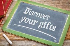 Discover your gifts on blackboard Stock Images