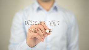 Discover Your Strengths , man writing on transparent screen. High quality Royalty Free Stock Photo