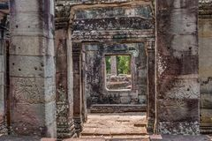 Discovered in the midst of the Cambodian jungle the Angkor Complex. Temples emerge from the Cambodian jungle to once again amaze us with what marvels ancient man stock photo