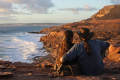 Discoverers. Couple on the rock-cliffs in west-Australia stock photography