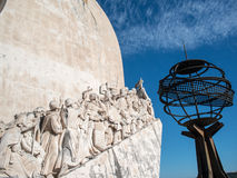 Discoveries monument and globe Stock Photography