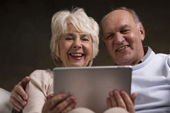 Discovering fun that internet can bring to their elderly life Royalty Free Stock Image