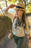 Adventure woman hiker hiking in Tuscany & looking into distance Stock Photos