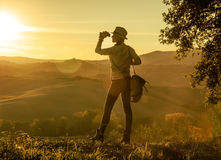Woman hiker looking into the distance through binoculars Royalty Free Stock Photography