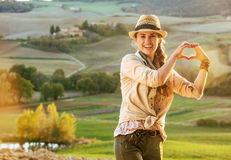Woman hiker in Tuscany showing heart shaped hands Royalty Free Stock Photos