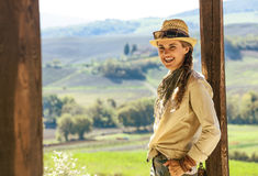 Smiling adventure woman hiker in hat hiking in Tuscany Royalty Free Stock Image