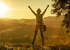 Woman hiker enjoying sunset in Tuscany and rejoicing Royalty Free Stock Photography
