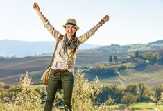 Smiling active woman hiker on Tuscany hike rejoicing Stock Photos