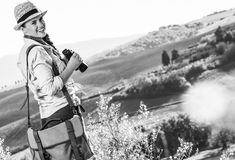 Smiling adventure woman hiker hiking in Tuscany with binoculars. Discovering magical views of Tuscany. smiling adventure woman hiker in hat hiking in Tuscany Stock Images