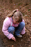 Discovering nature. Little girl searching for worms and other little creatures Royalty Free Stock Images