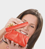 Discovering a surprise. Happy young woman opening a red gift box.Shot with Canon 70-200mm f/2.8L IS USM Royalty Free Stock Images