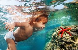 Discovering underwater treasures Stock Photography